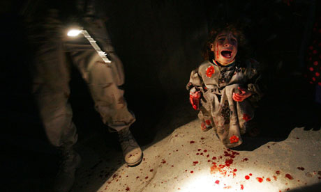 Civilians gunned down by U.S. forces in Iraq...and a child covered in blood cries.