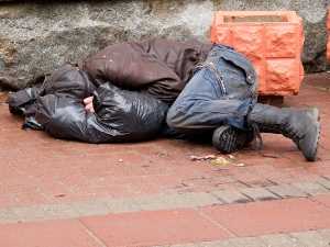 bigstock-Homeless-man-sleeps-on-a-pavem-32824019