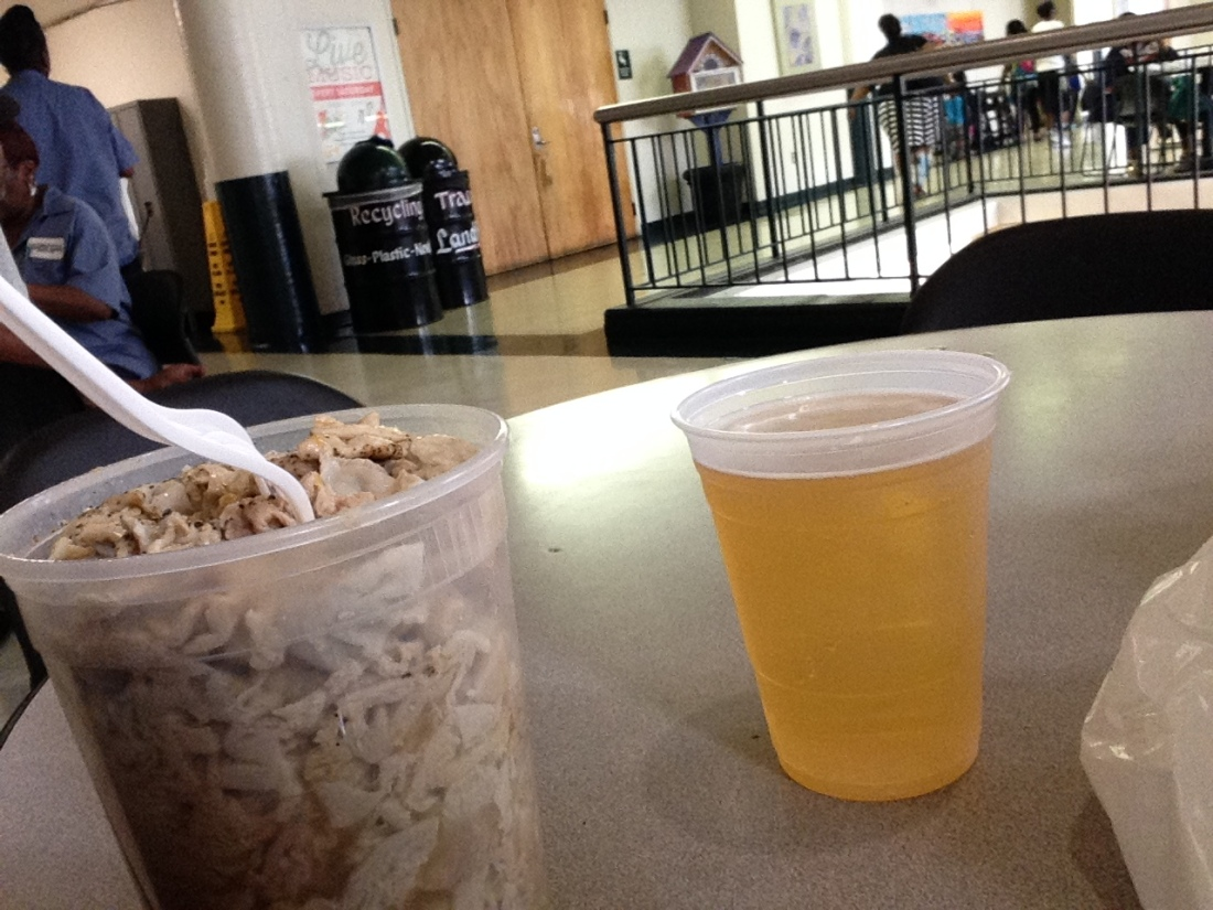 My cousin's first meal at Lexington Market. Chitterlings and beer! LOL!