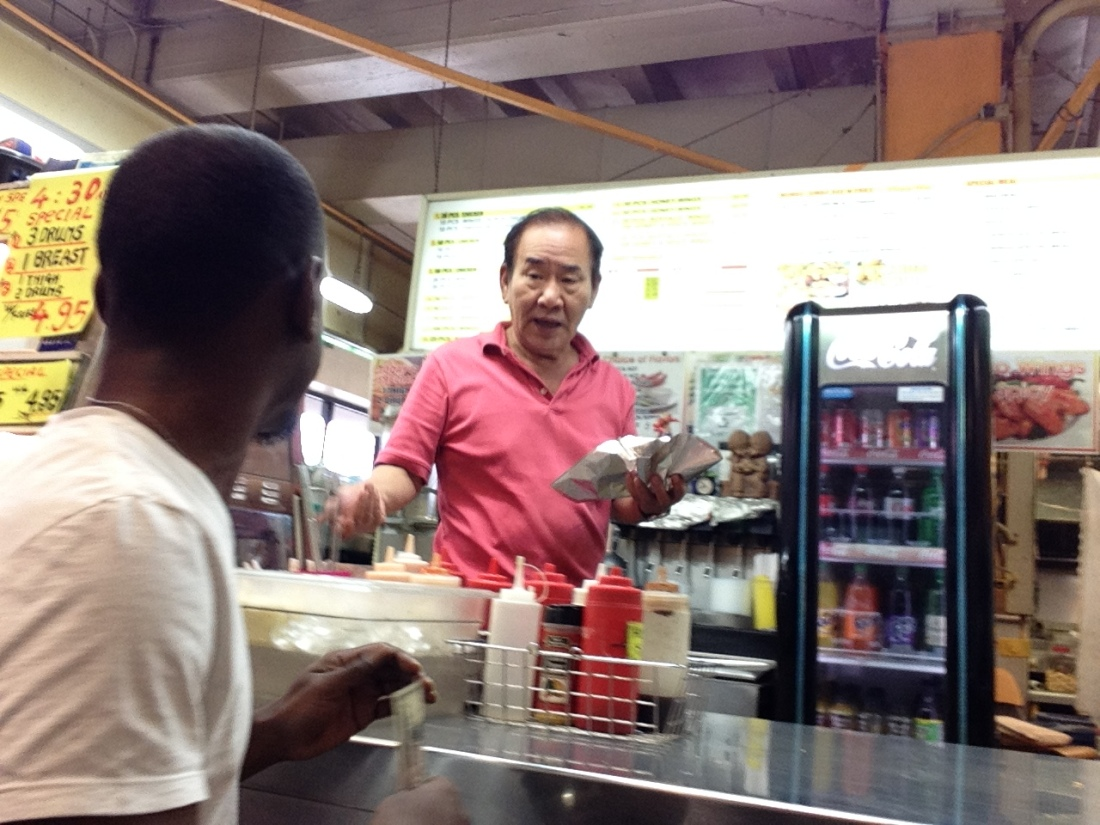 Would you ever see this the 'other way' around? Hell no! A Korean buying food from a Black man? Those pigs they sell would fly first!