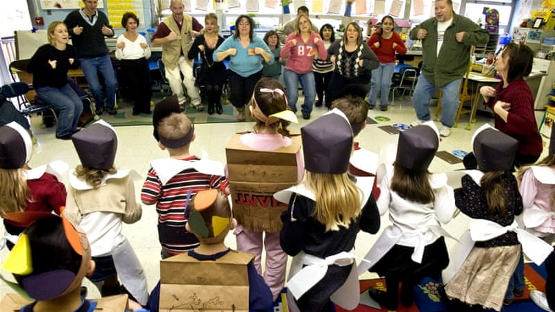 """Kindergarten students, dressed as pilgrims and Native Americans, show their parents and grandparents how to do the """"Mr Turkey Gobble"""" in Danville, PA on November 20, 2008 [AP Photo/Bill Hughes]"""